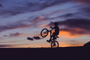 riding a wheelie into the sunset is the goal of Learn to Ride a book